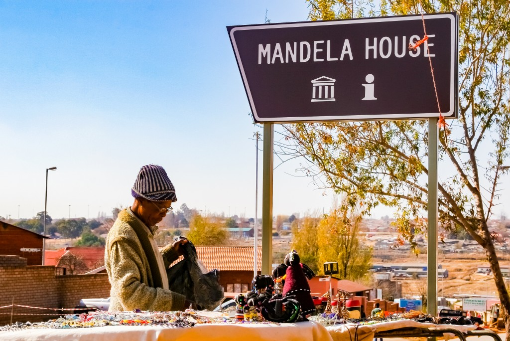 Old Lady selling African Curios on sale Outside Nelson Mandela's house in Vilakazi Street Soweto