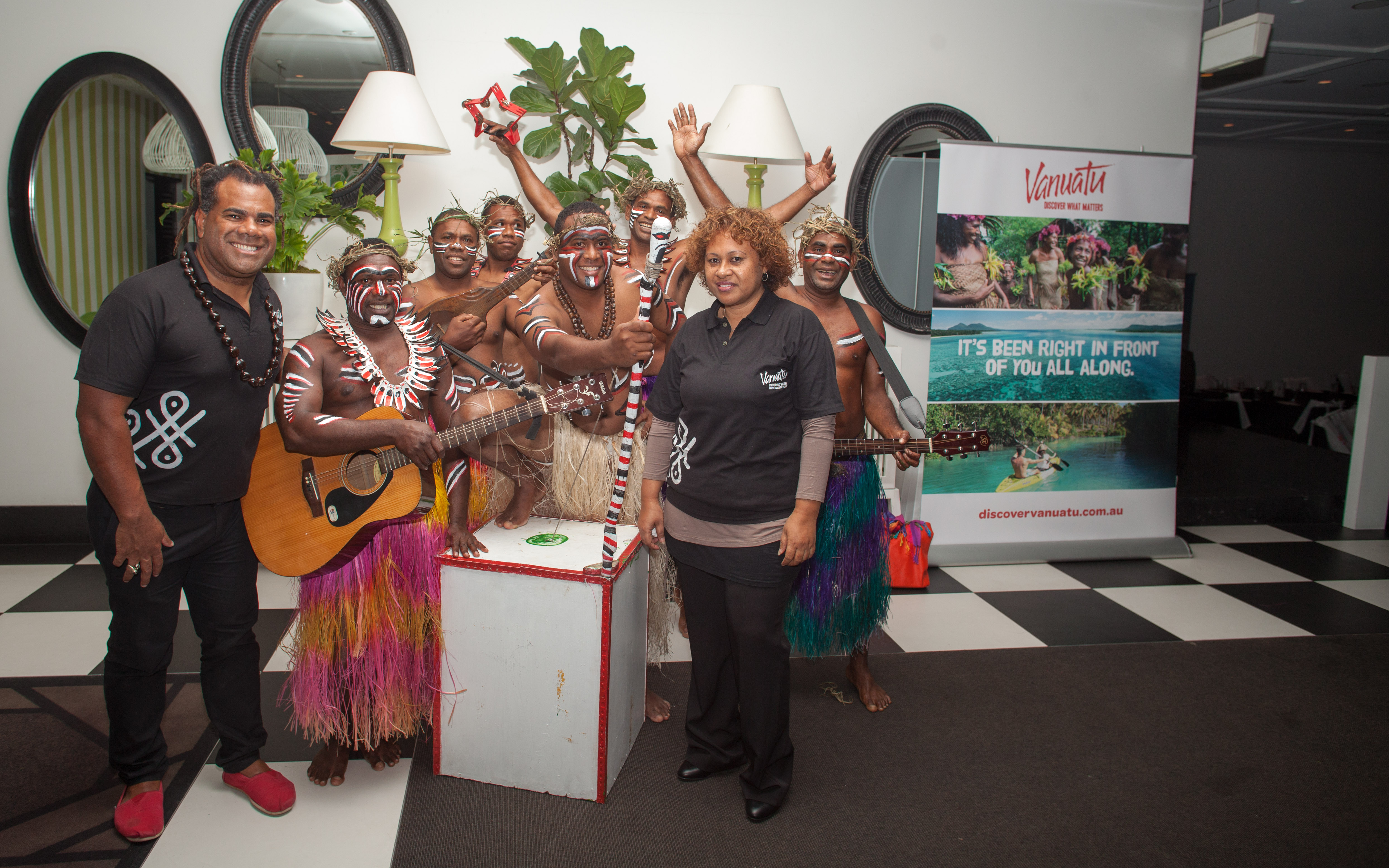 VTO's marketing manager Allan Kalfabun and general manager Linda Kalpoi with traditional Vanuatu band