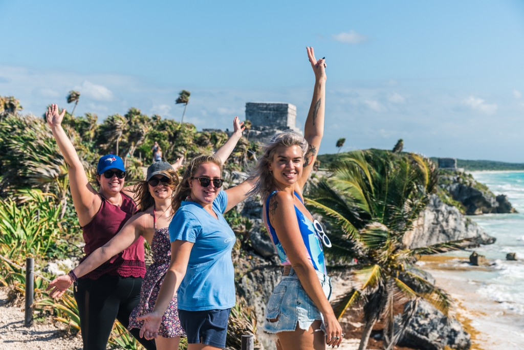 Intrepid Travel-mexico_tulum_travellers_ruins_smiling_group_25