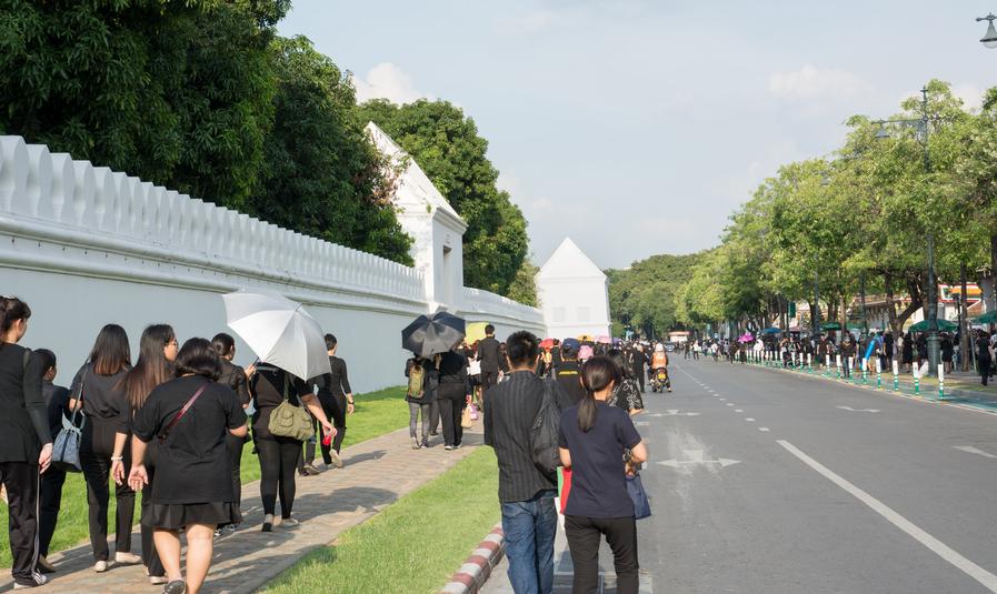 Bangkok, Thailand - October 14, 2016: Citizens of Bangkok walking around the Great Palace, to pay respect to the deceased King Bhumibol Adulyadej