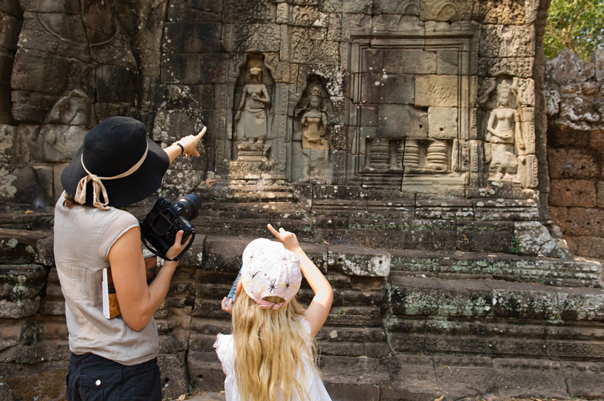 Mother And Daughter Looking At Ancient Temple