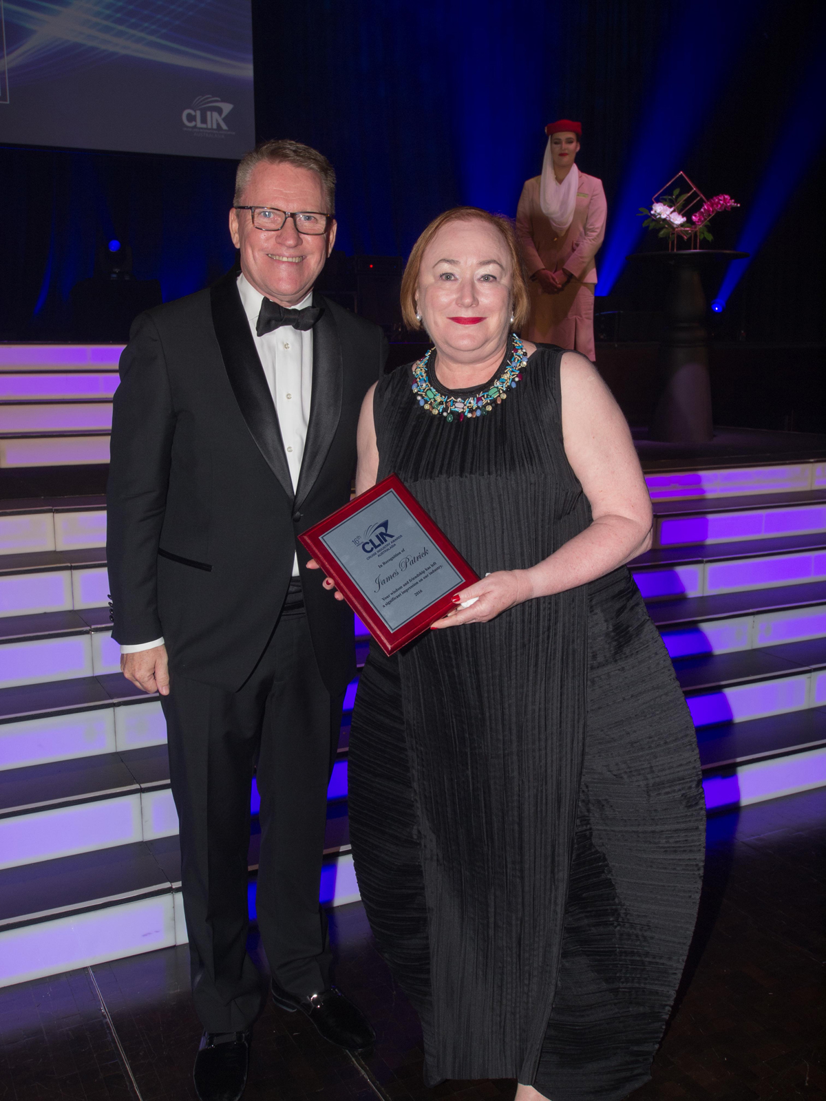 CLIA's Steve Odell presents Wiltrans International MD Diane Patrick with a posthumous award for her late husband, James Patrick