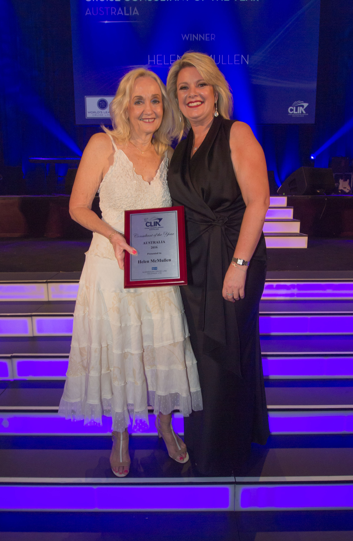 Helen McMullen, Cruise Holidays QLD, receives her award from NCL's Nicole Costantin