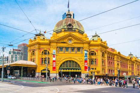 Melbourne, Australia - November 3, 2015: People passing outside the entrance of Flinders Street railway station in Melbourne, Australia. The busiest station in Melbourne.