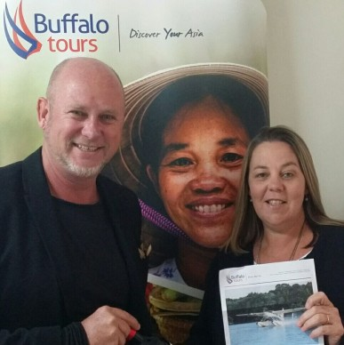 One of the lucky winners Debbie Tripp being award her prize by Matthew Edwards of Buffalo Tours