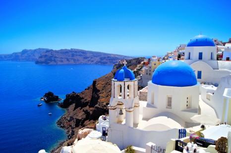 Classic Santorini scene with famous blue dome churches, Greece