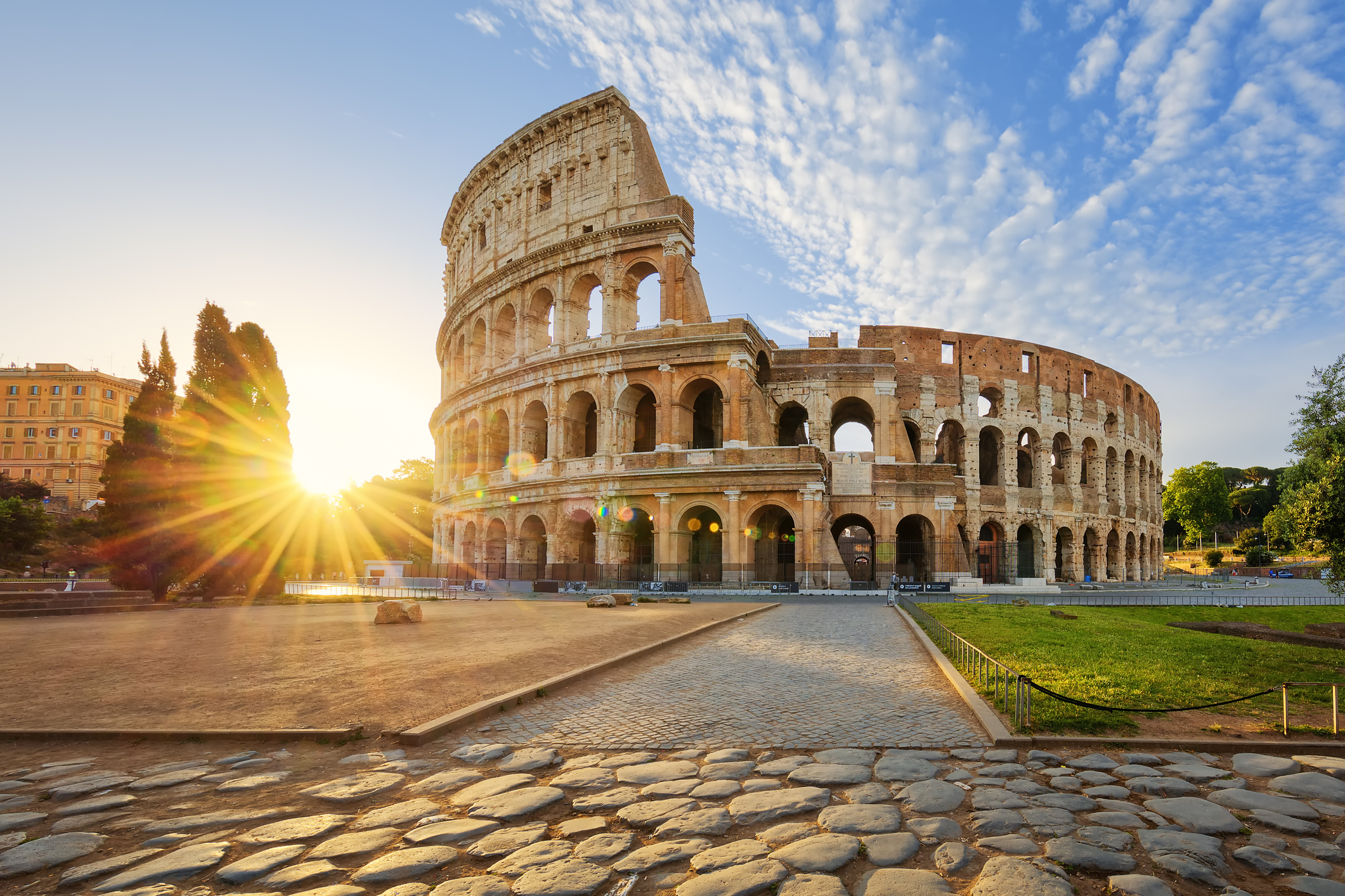 Colosseum in Rome and morning sun, Italy