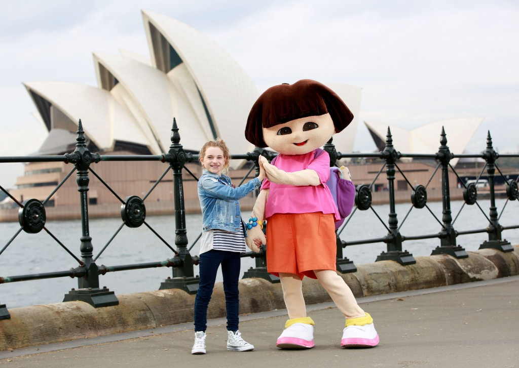 Sabre Norris with Dora the explorer on Sydney Harbour for the launch of the P&O Pacific Explorer. Photo by Damian Shaw