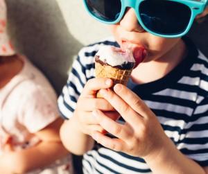 Cute little boy eating ice cream in closeup