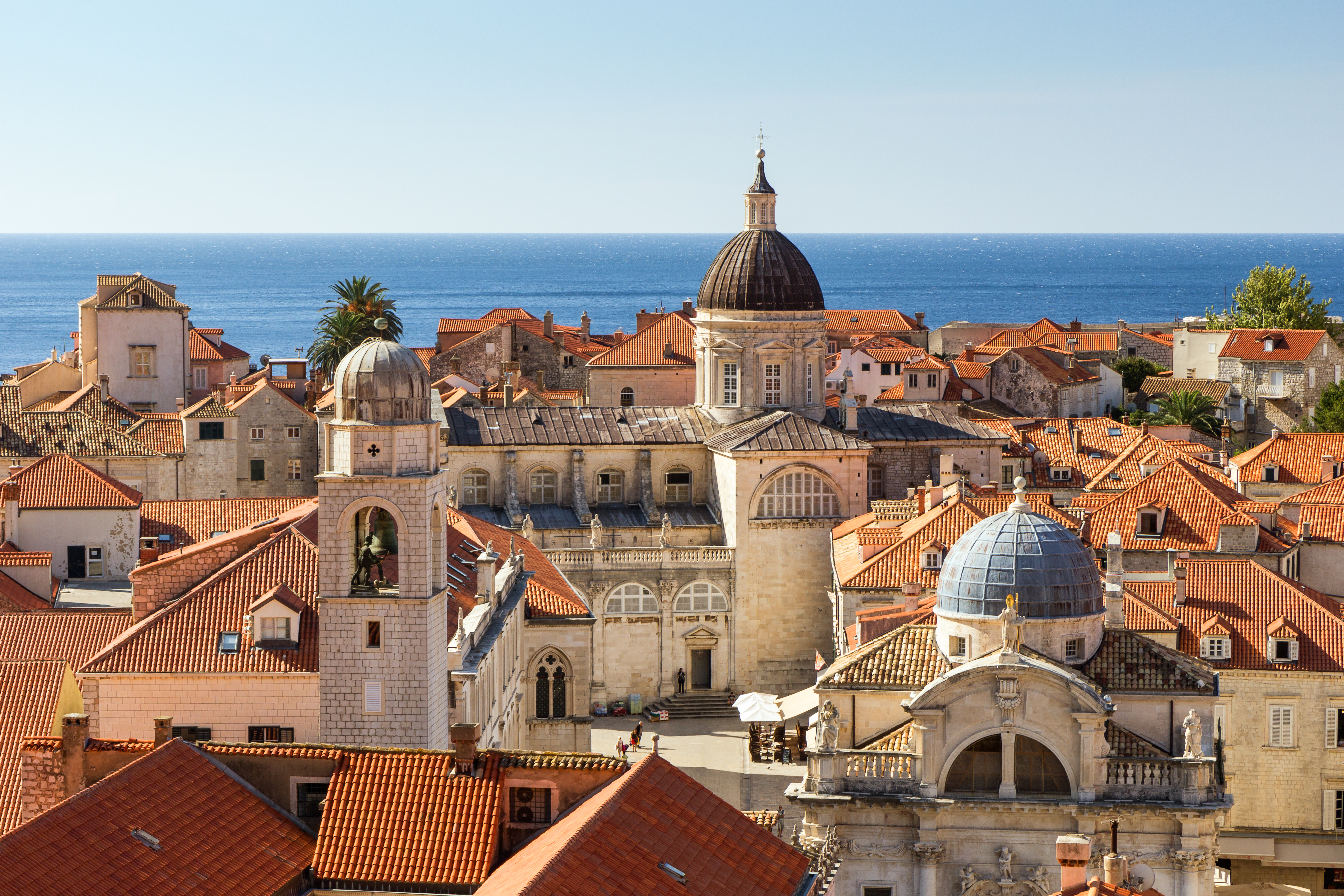 Old Town's skyline with red roofs and churches' and cathedrals' towers in Dubrovnik, Croatia, viewed slightly from above.