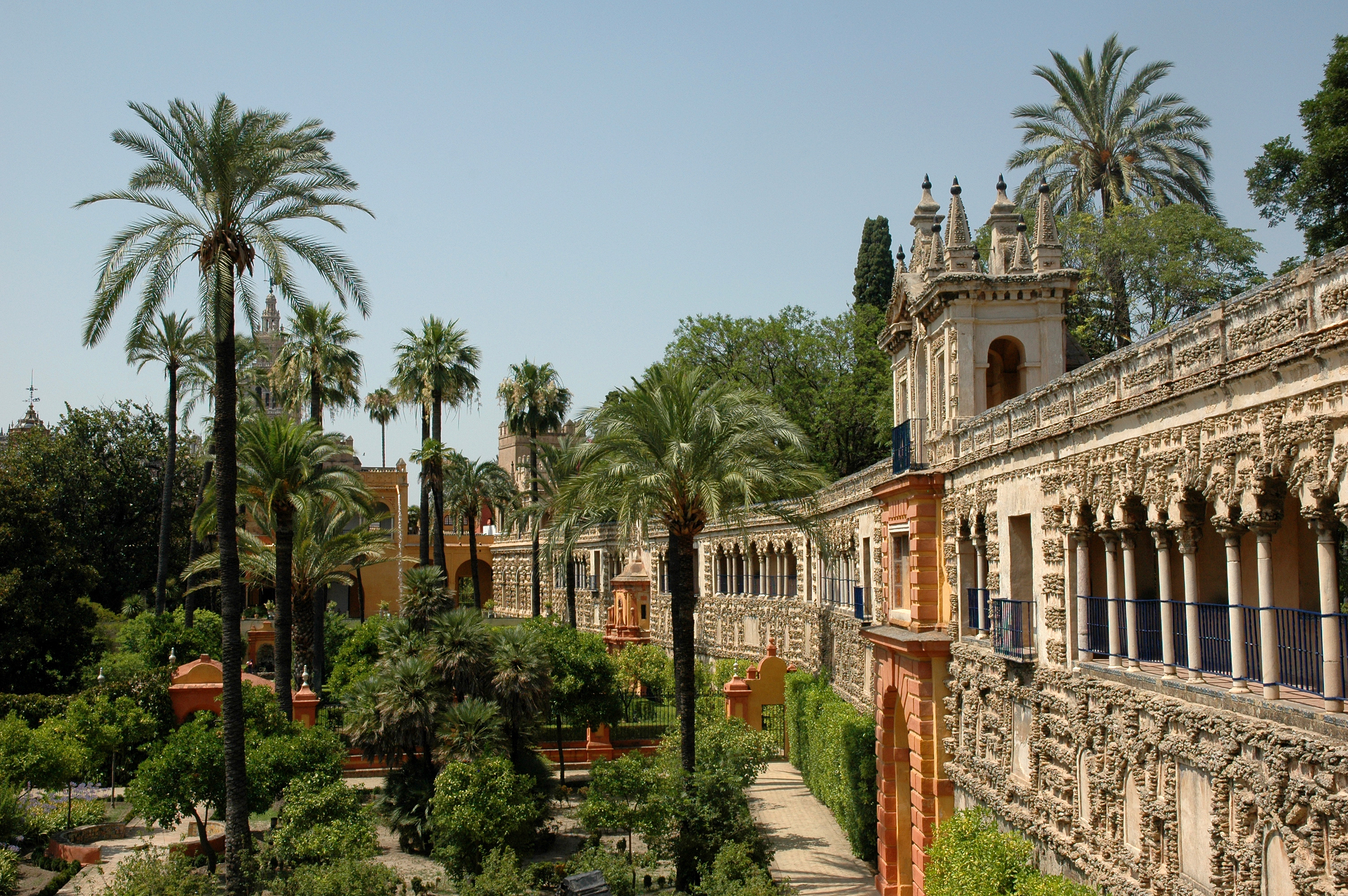 Alcazar Gardens Seville Spain with palm-trees in daylight