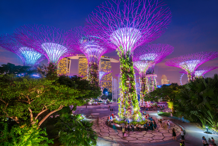 Illuminated Supertrees and Skywalk in Gardens by the bay in Singapore at night