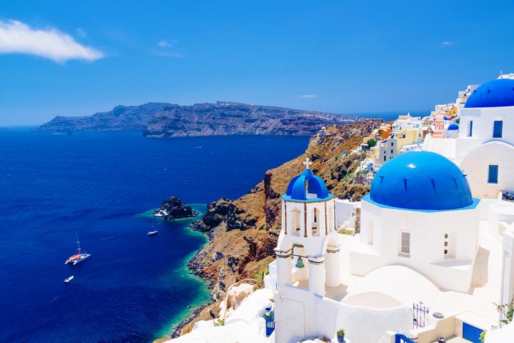 White architecture and churches with blue domes, Oia, Santorini, Greece