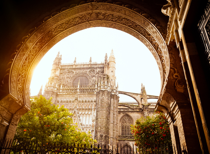 Entrance to Patio de Naranjas and Seville Cathedral (Spain).