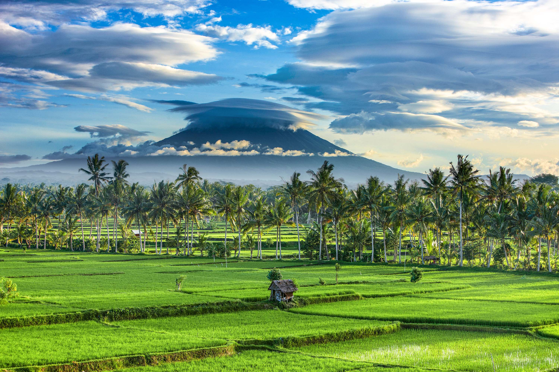 Dramatic sky over the volcanic peak of Gunung Agung and the rice fields, near Ubud, Bali, Indonesia