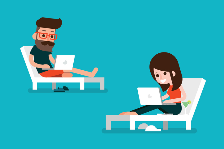 Man and woman using computer on beach chair.