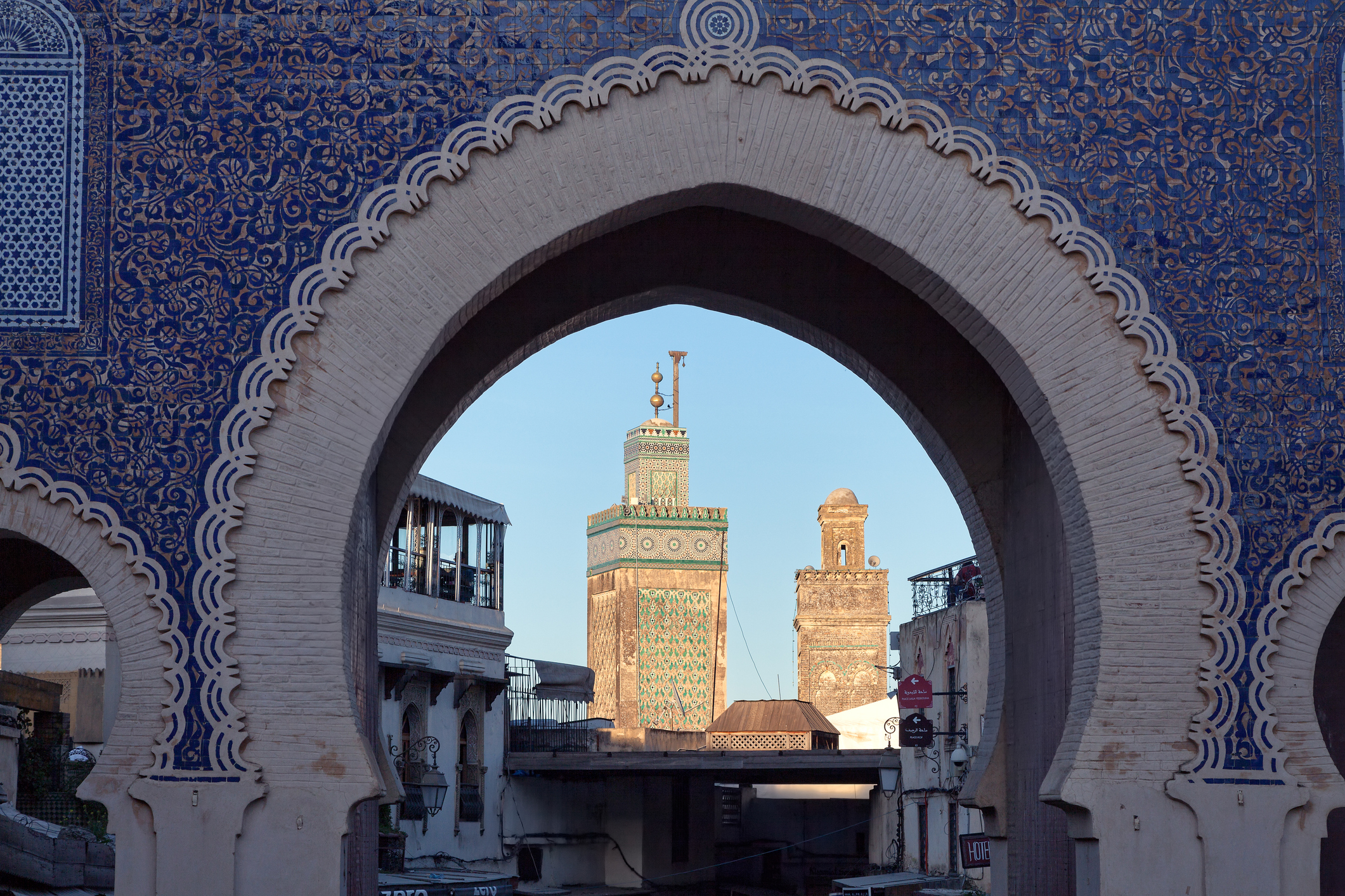 Fez, Morocco - March 7, 2015: Looking through Bab Boujaloud Gate into the ancient Fez El Bali Medina, Morocco.