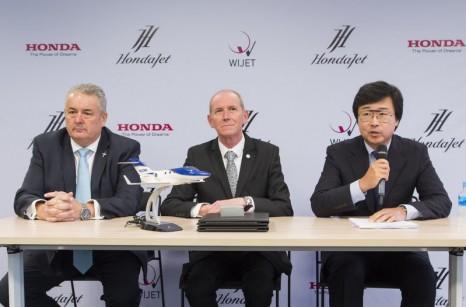 Mr. Simon Roads, senior division director of sales at Honda Aircraft Company, Mr. Michimasa Fujino, CEO of Honda Aircraft Company, and Mr. Patrick Hersent, CEO of Wijet, after signing a Memorandum of Understanding (MoU) today for multiple HondaJets to upgrade the Wijet fleet. (PRNewsfoto/Honda Aircraft Company)