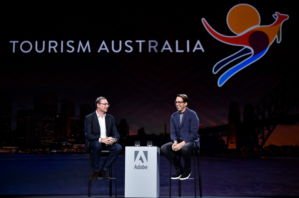 John O'Sullivan, Managing Director Tourism Australia (L) speaks with Brad Rencher, EVP and GM of Adobe Experience Cloud during Adobe Summit at the Venetian on Tuesday, March 27, 2018, in Las Vegas. (Photo by Jeff Bottari/Invision for Adobe/AP Images)