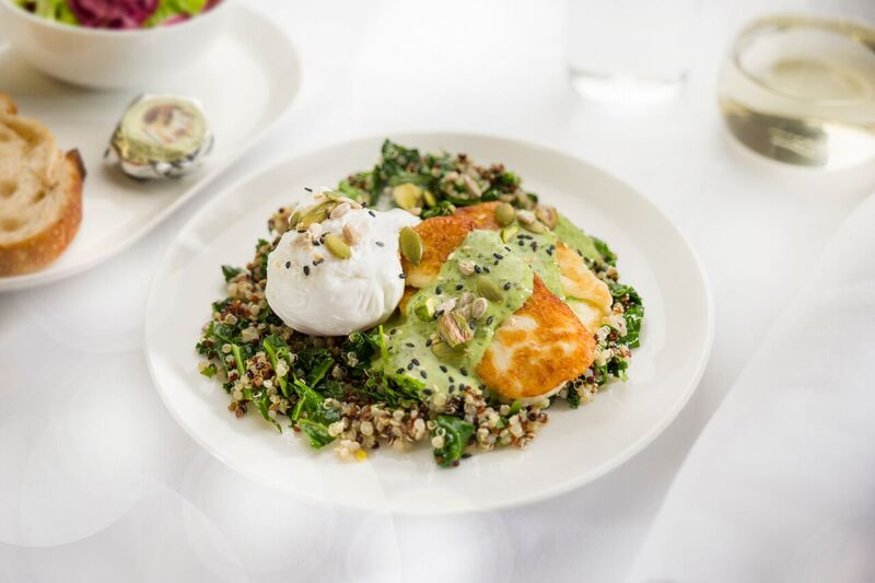Poached-eggs-with-kale-quinoa-grilled-haloumi-pistachios-seeds-and-herbed-tahini-dressing-Business-breakfast-menu-ex-PERLHR-B787-QF9_preview
