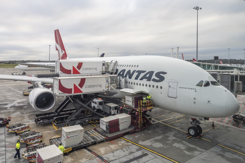 Melbourne, Australia - May 26, 2017: Qantas A380 airplane docked for loading luggage and catering at Melbourne Airport.