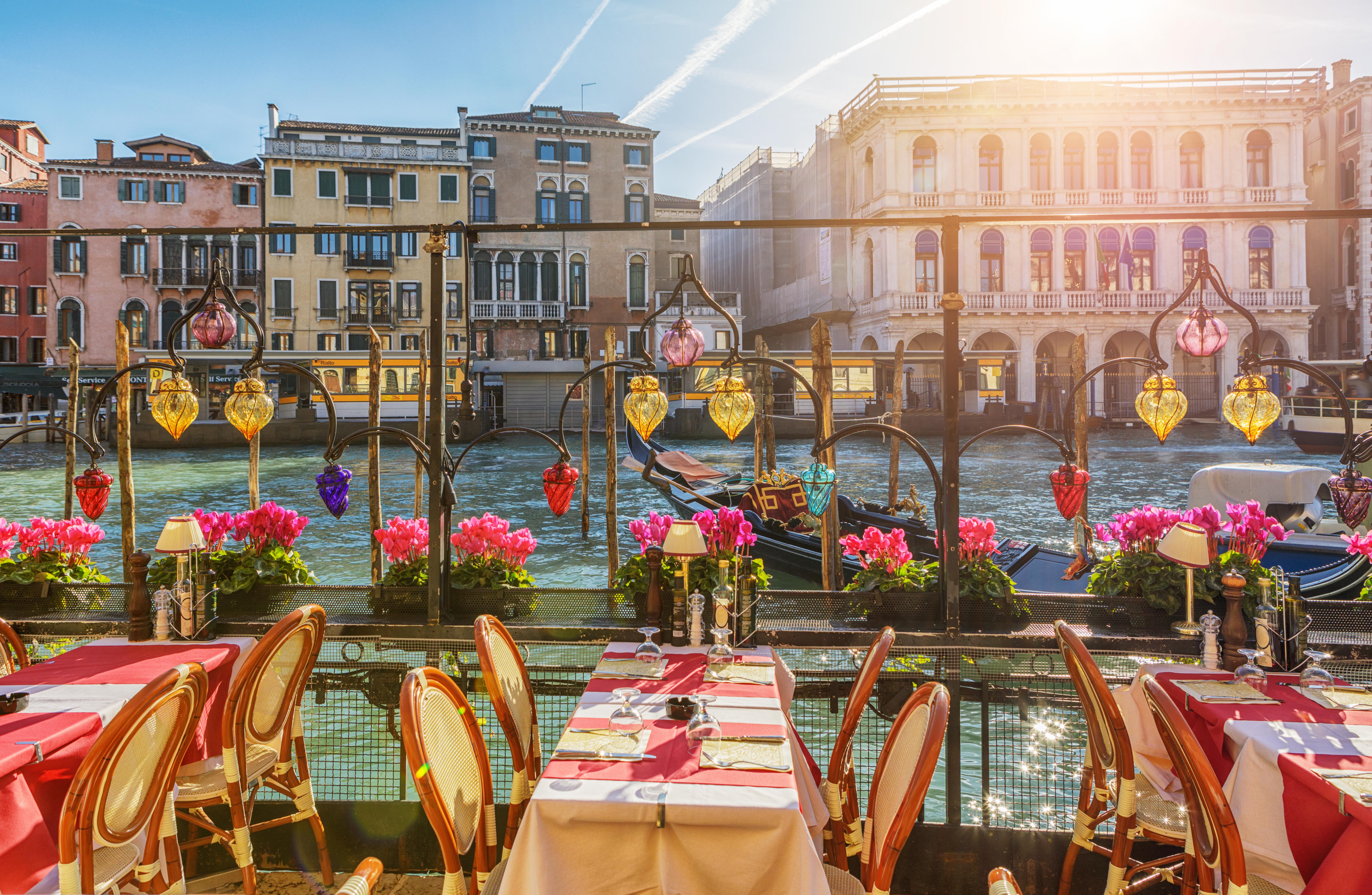Restaurant Tables Near The Canal of Venice, Italy