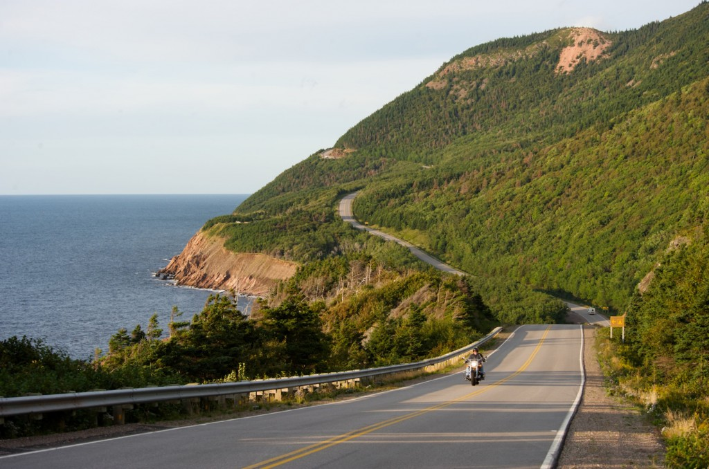 Motorcycles travel along the Cabot Trail in Cape Breton Highlands National Park near Cheticamp
