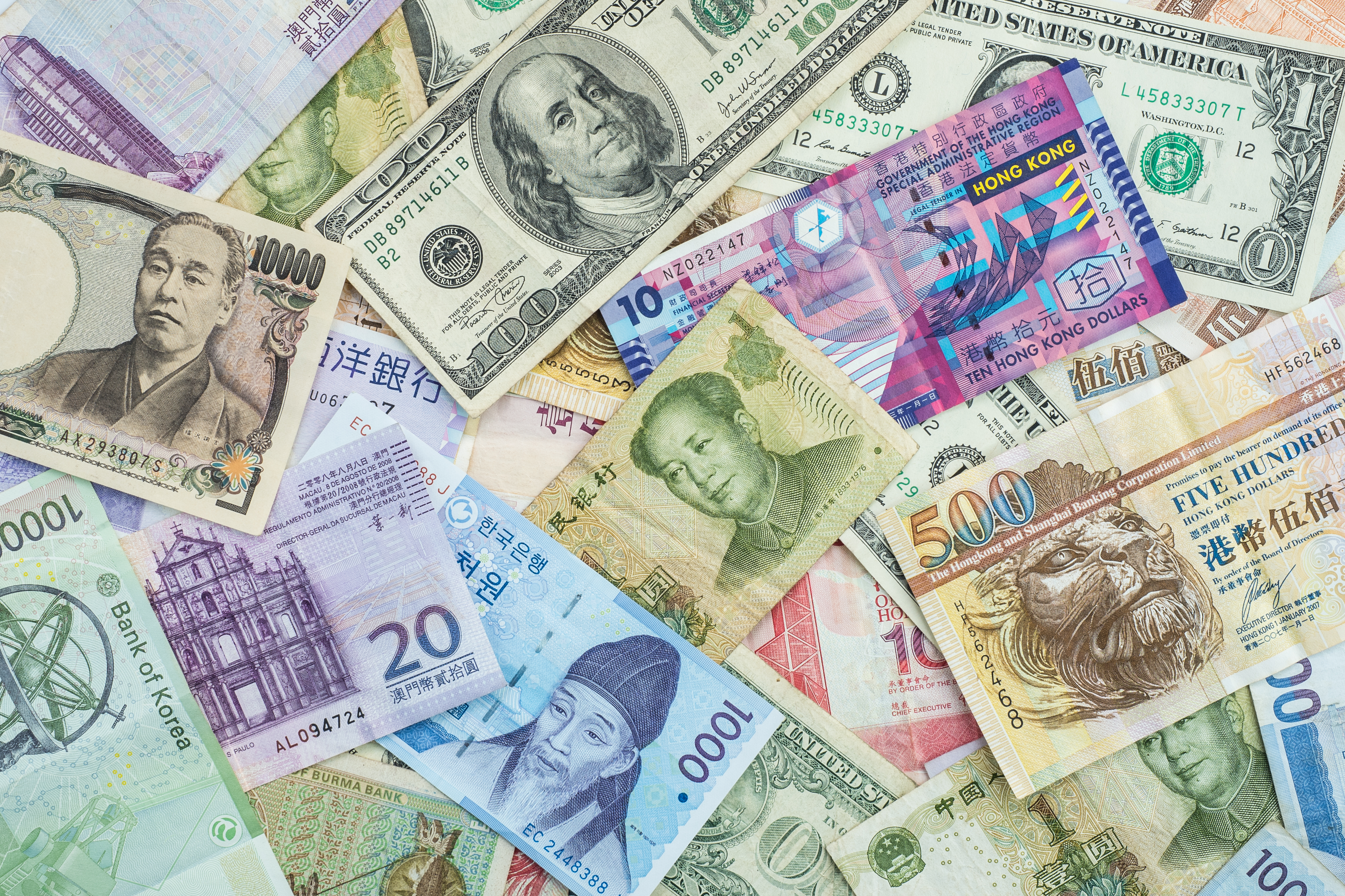 International banknote background for global currencies concept for money exchange business