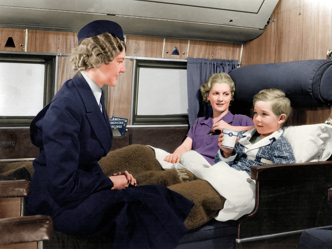 Hostess attends to mother and child on the Douglas DC4E in 1939. Colorized by Benoit Vienne. Source: AirlineRatings.com