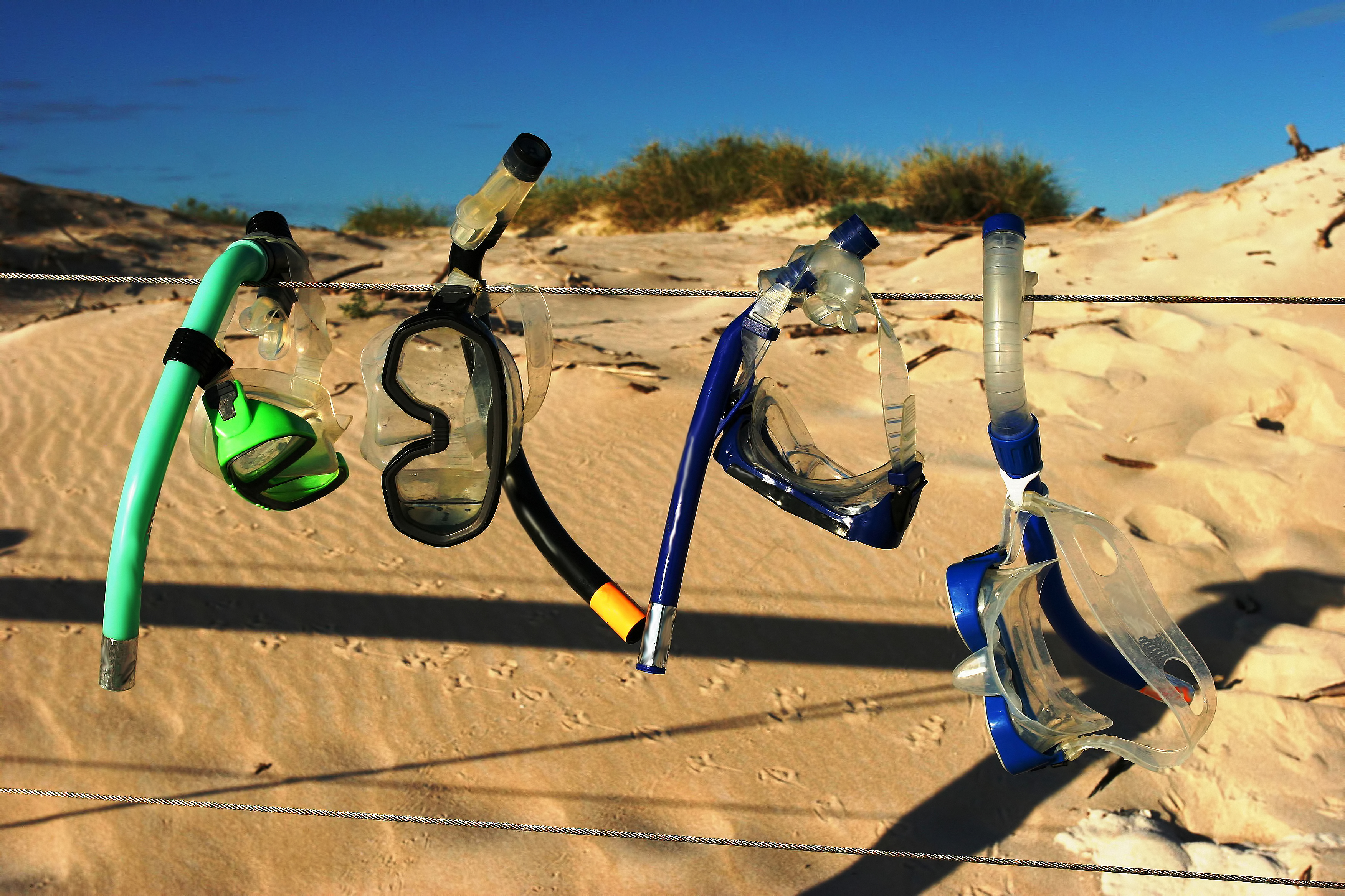 Snorkelling Gear Drying on a Wire Fence