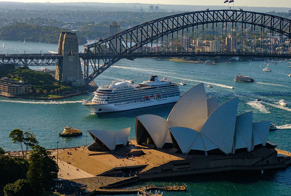 Aerial view of the Viking Sun near the Harbour Bridge and Opera House, Sydney, Australia.