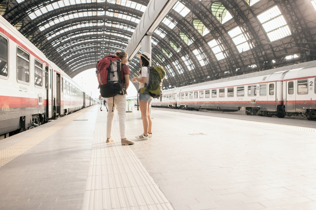 Backpackers at Milan train station, Italy-medium
