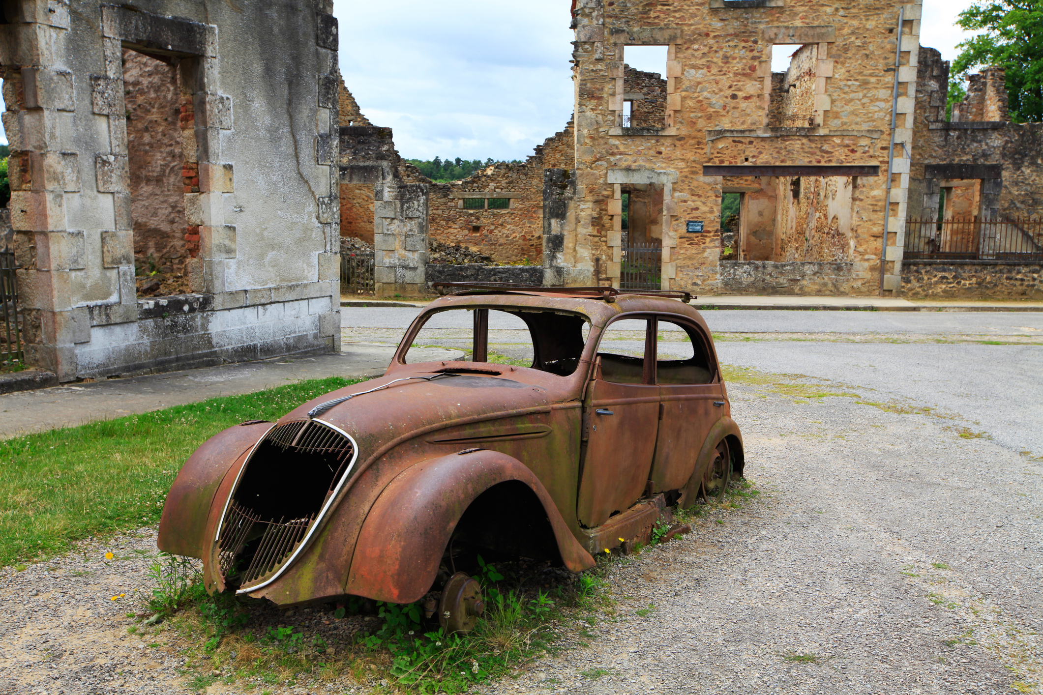 """Oradour-sur-Glane is a commune in the Haute-Vienne department in the Limousin region in west-central France. The original village was destroyed on 10 June 1944, when 642 of its inhabitants, including women and children, were massacred by a German Waffen-SS company. A new village was built after the war on a nearby site but on the orders of the then French president, Charles De Gaulle, the original has been maintained as a permanent memorial."""