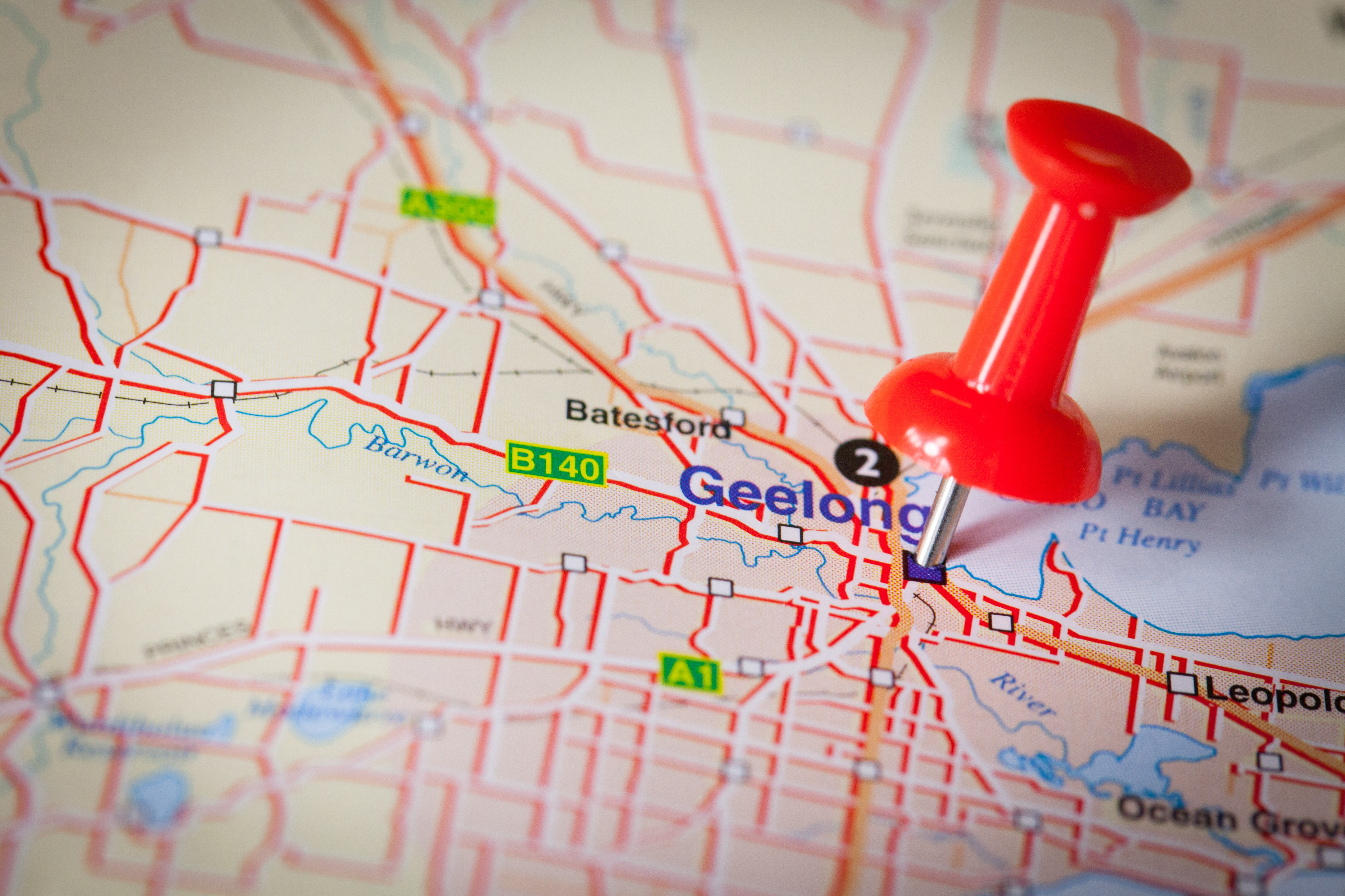 Geelong located with a push pin on a map. Victoria, Australia.