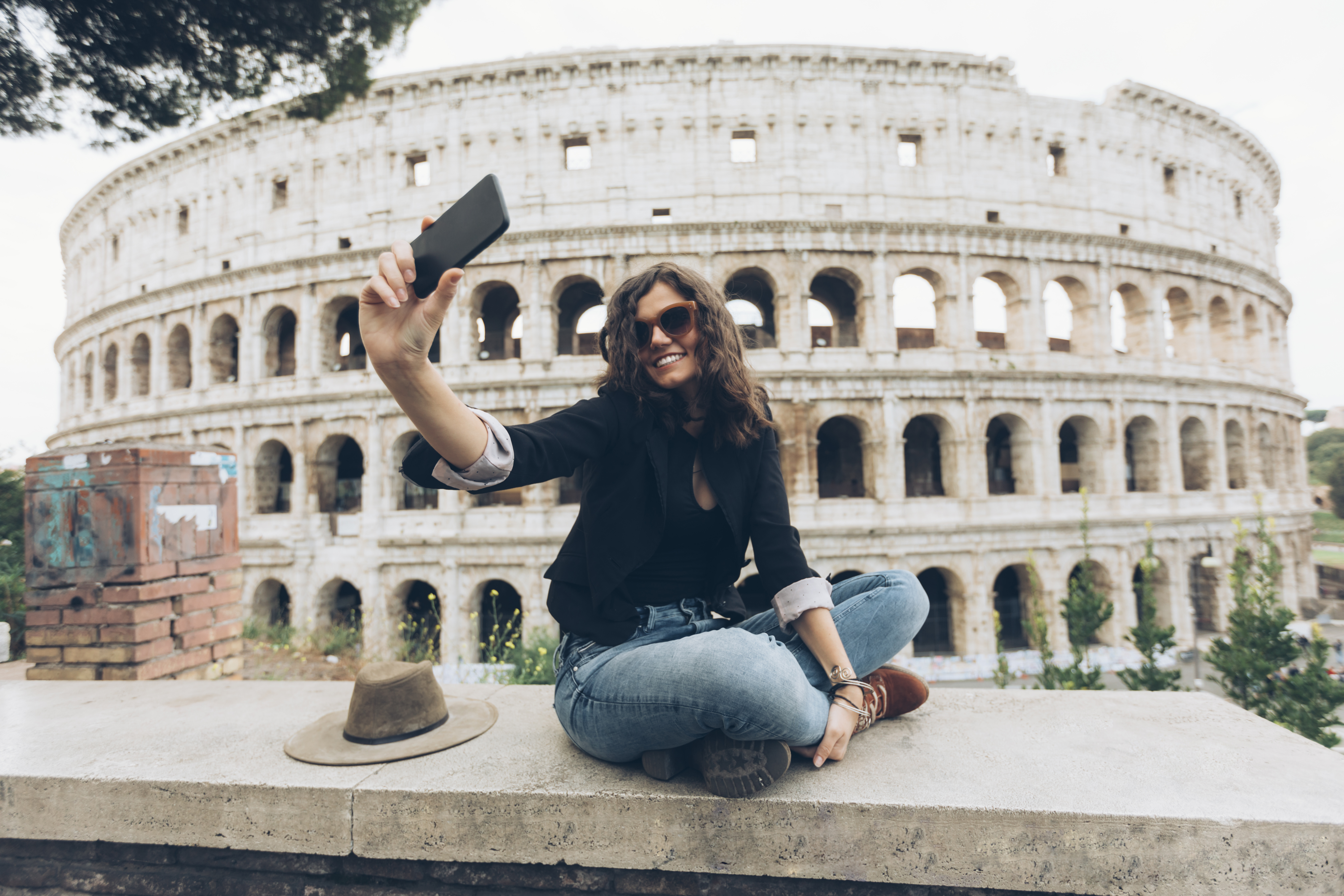 Young woman taking selfie in front of Coliseum
