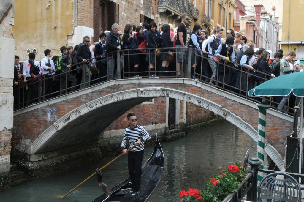 Tourists in the crowded the bridge in Venice.