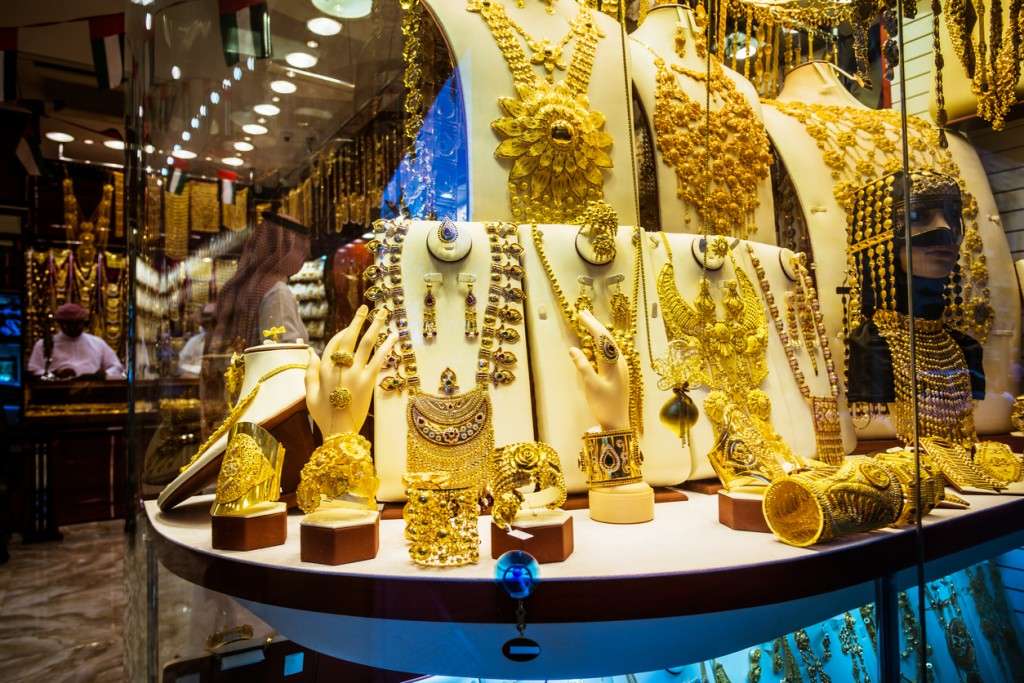 Variety of golden amber rings for sale at a store