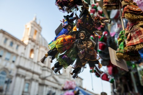 Rome, Italy - December 21, 2013: Christmas in Piazza Navona, in Rome. Handicrafts figuring befana sold by the street vendor shops.