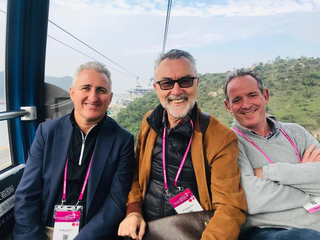 Michael Gazal (TravelManagers), Andrew Clark (HKTB) Paul Gorman (Luxury Escapes) soaring high above on the Ngong Ping 360 cable car