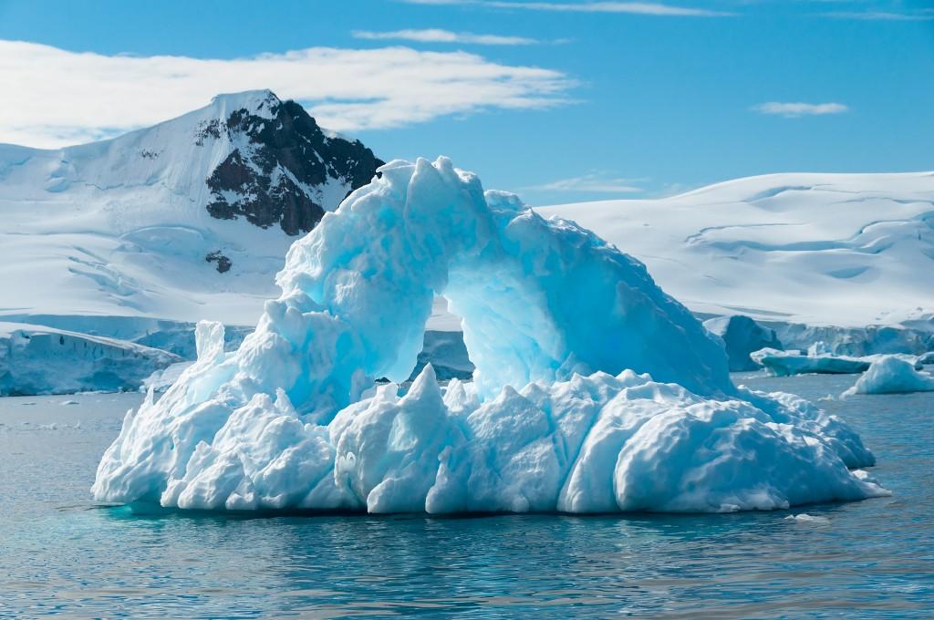 Antarctica_Iceberg_Arch_shutterstock_173614724