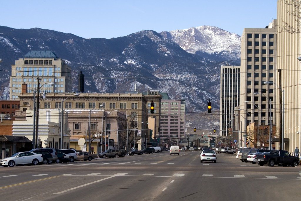 Downtown Colorado Springs Colorado looking west from Pikes Peak Avenue towards Pikes Peak and the Rocky Mountains.