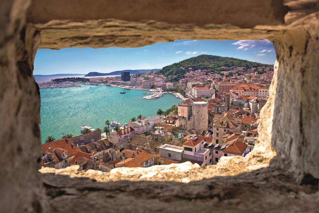 Split bay aerial view through stone window