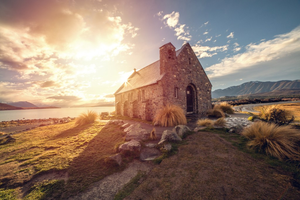 Church of the Good Shepherd and Lake Tekapo. Beautiful light, sunbeam on the church.