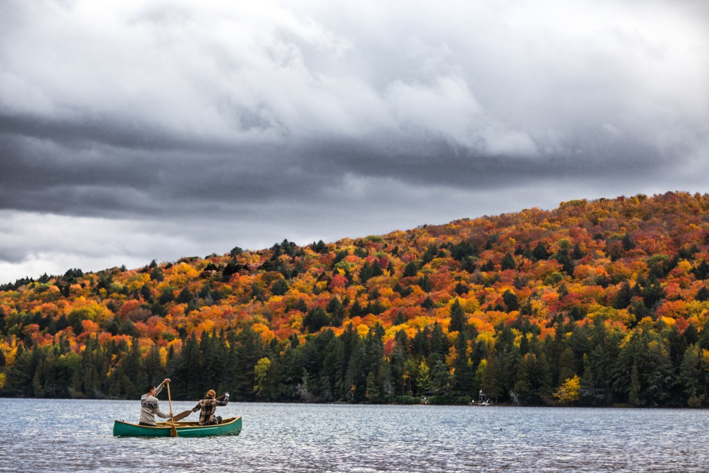 Couple enjoying a ride on a typical canoe in the Algonquin Park, Ontario - Canada.