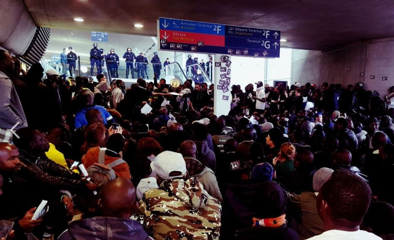 Migrants flood French airport terminal, demand to see PM and Air France CEO