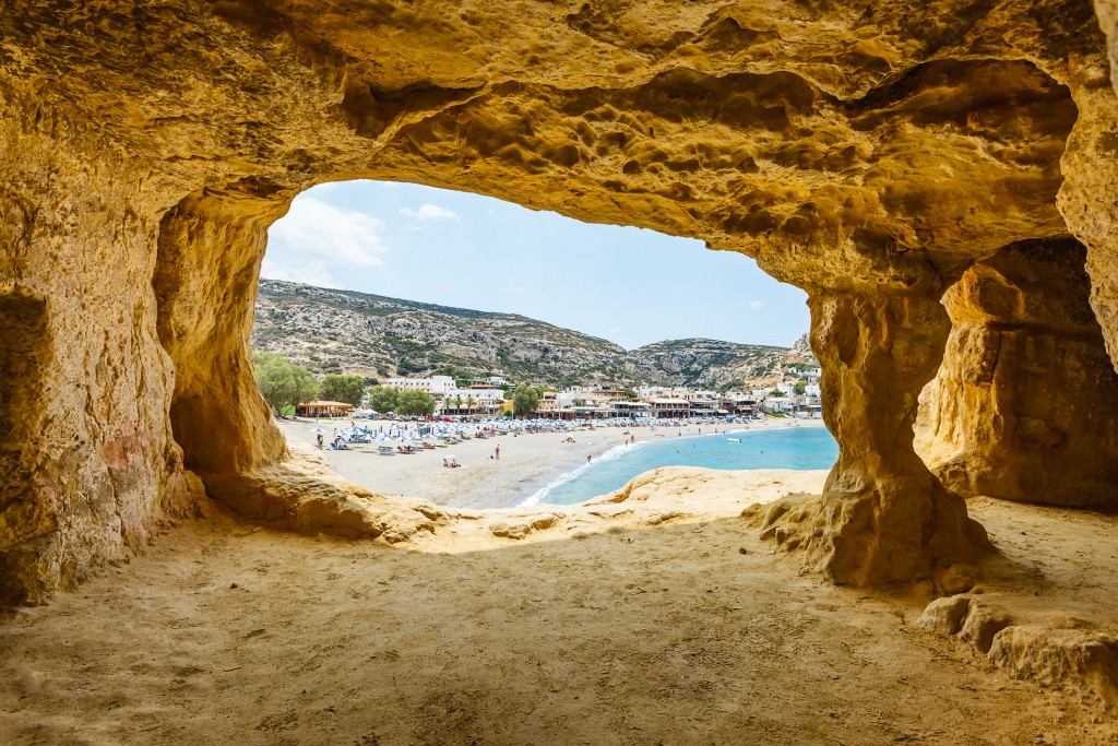 Matala beach, view from a cave in cliff used by hippies, Crete island, Greece.