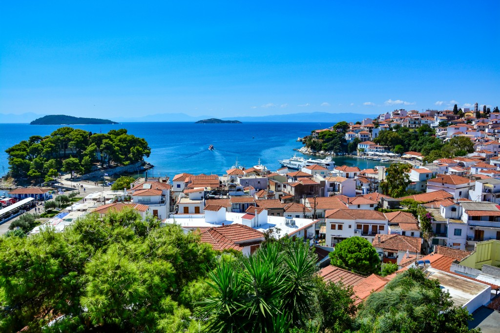 Although peak-season might make beach-going a hassle, it may provide the perfect excuse to head further inland to see Skiathos Town.