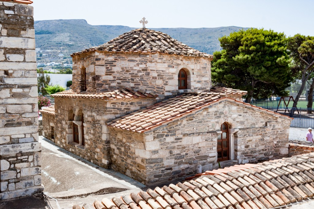 Tourists visiting the brick byzantine historical church of Panagia Ekatontapiliani in Paros, cyclades islands, Greece