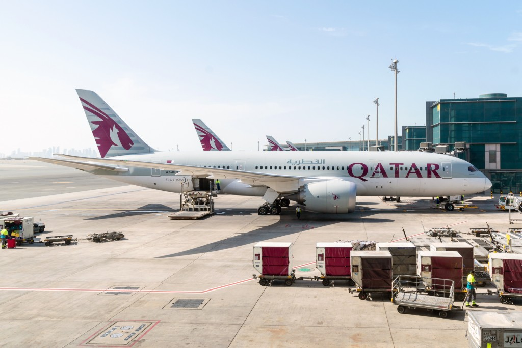 AirHelp's best airline in the world Qatar Airways and one of its planes at Hamad International Airport (another high achiever in the rankings).