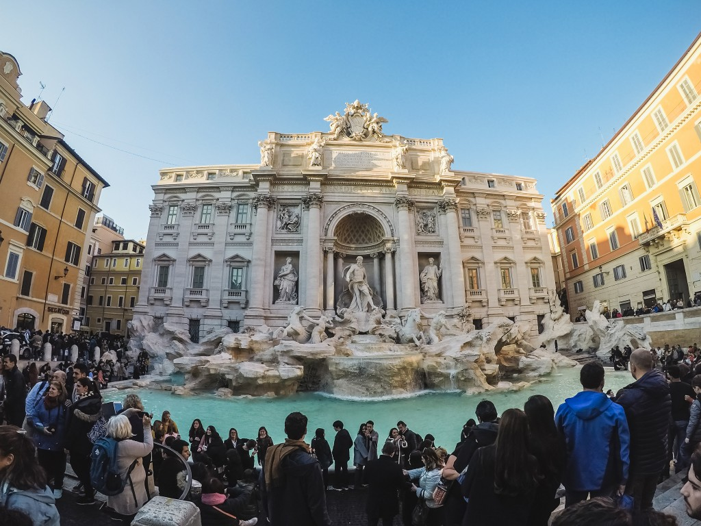 Many tourists around the Fontana Di Trevi fountain at the Piazza Di Trevi.